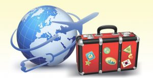 Vacationer's suitcase and airplane flying around the globe for dental care in Costa Rica