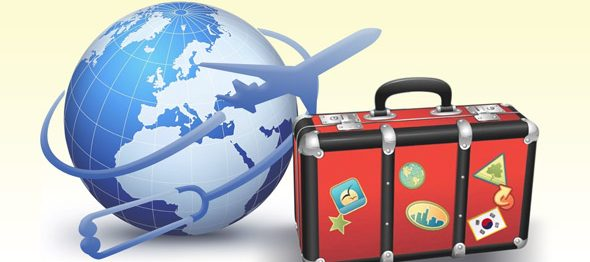 Airplane flying around the globe with a tourist's suitcase