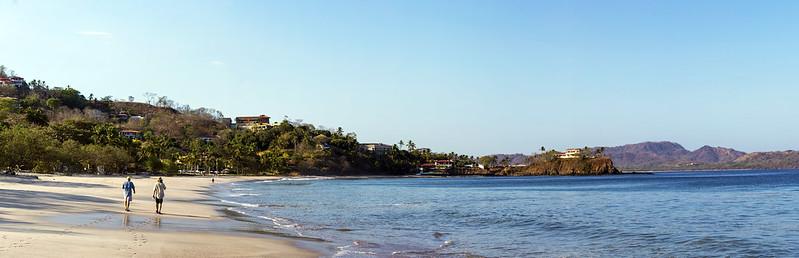 Dental care tourists enjoying a walking along a tropical ocean beach in Costa Rica
